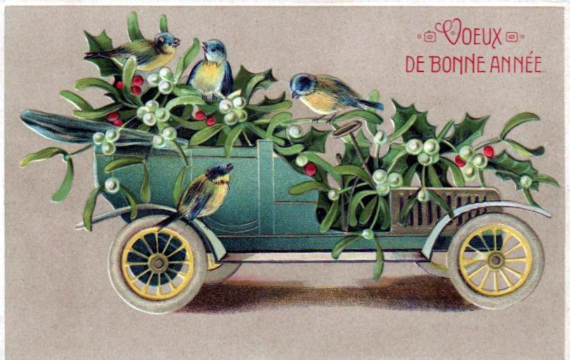 """Une voiture ancienne avec du houx et des oiseaux. Une inscription """"voeux de bonne année"""" est située en haut à droite."""